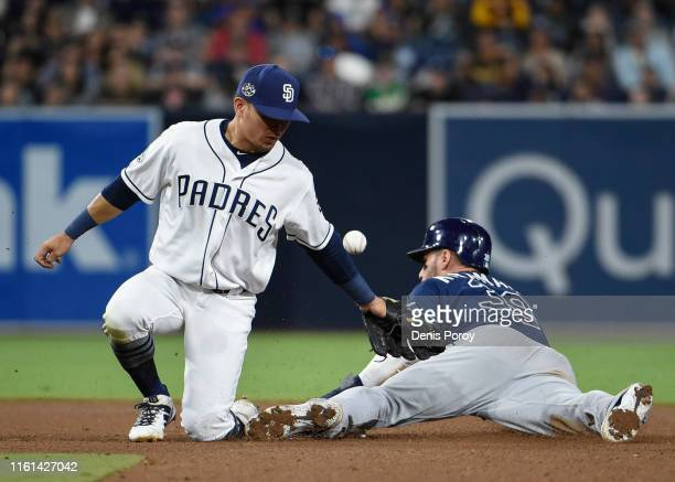 Luis Urias of the San Diego Padres drops the ball as Kevin Kiermaier of the Tampa Bay Rays steals second base during the fourth inning of a baseball...