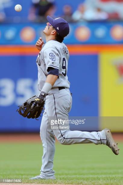 Luis Urias of the San Diego Padres reacts to failing to force an out during the game between the San Diego Padres and the New York Mets at Citi Field...