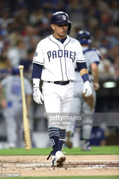 Luis Urias of the San Diego Padres reacts to striking out looking during the second inning of a game against the Los Angeles Dodgers at PETCO Park on...