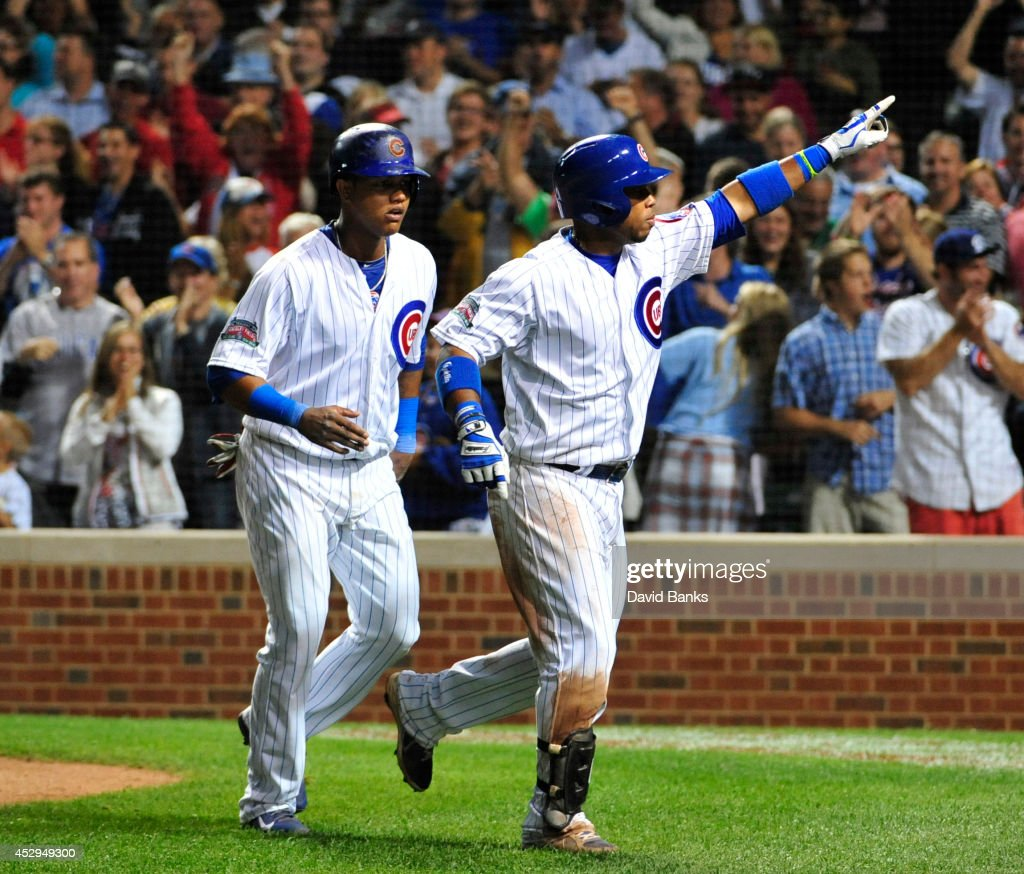 Luis Valbuena #24 of the Chicago Cubs gestures after hitting a two-run home run against the Colorado Rockies during the eighth inning on July 30, 2014 at Wrigley Field in Chicago, Illinois.