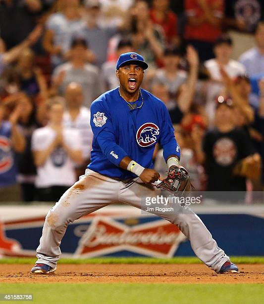 Luis Valbuena of the Chicago Cubs reacts throwing Dustin Pedroia of the Boston Red Sox out at first base for the final out of a 21 win at Fenway Park...