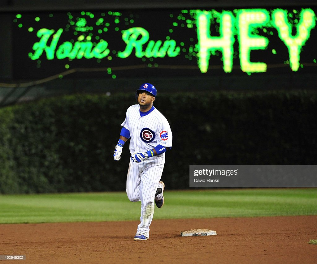 Luis Valbuena #24 of the Chicago Cubs rounds the bases after hitting a two-run home run against the Colorado Rockies during the eighth inning on July 30, 2014 at Wrigley Field in Chicago, Illinois.