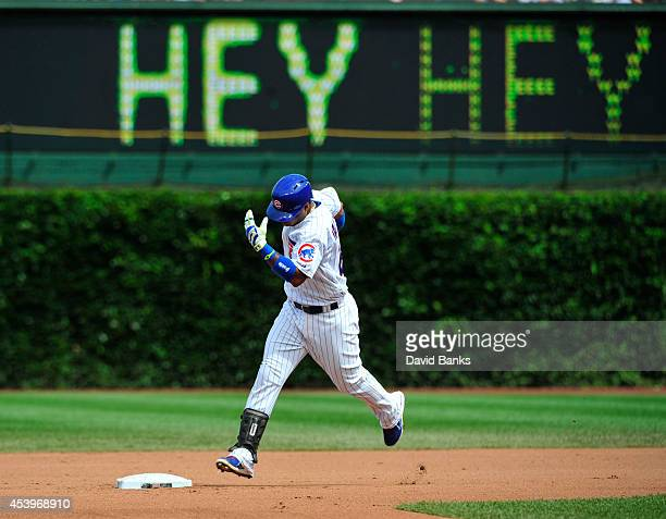 Luis Valbuena of the Chicago Cubs runs the bases after hitting a home run against the Baltimore Orioles during the fourth inning on August 22 2014 at...