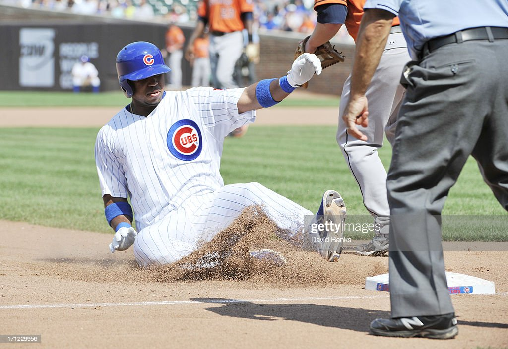Luis Valbuena #24 of the Chicago Cubs slides safely into third base with a triple against the Houston Astros during the seventh inning on June 23, 2013 at Wrigley Field in Chicago, Illinois.