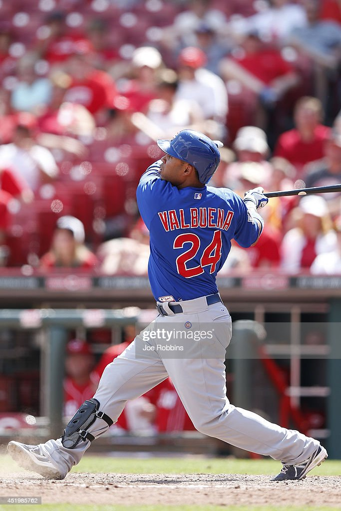 Luis Valbuena #24 of the Chicago Cubs triples to drive in two runs in the 12th inning of the game against the Cincinnati Reds at Great American Ball Park on July 10, 2014 in Cincinnati, Ohio. The Cubs won 6-4.