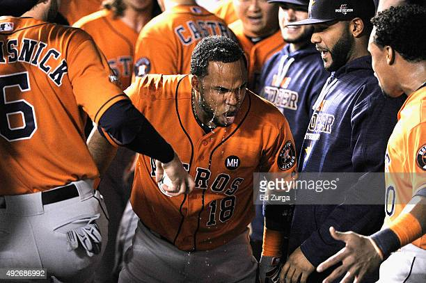 Luis Valbuena of the Houston Astros celebrates in the dugout after hitting a tworun home run in the second inning against the Kansas City Royals...