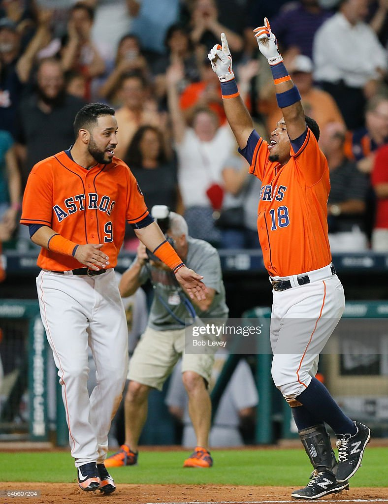 Luis Valbuena #18 of the Houston Astros celebrates with Marwin Gonzalez #9 after hitting a three run walkoff home run in the ninth inning to defeat the Oakland Athletics 10-9 at Minute Maid Park on July 8, 2016 in Houston, Texas.
