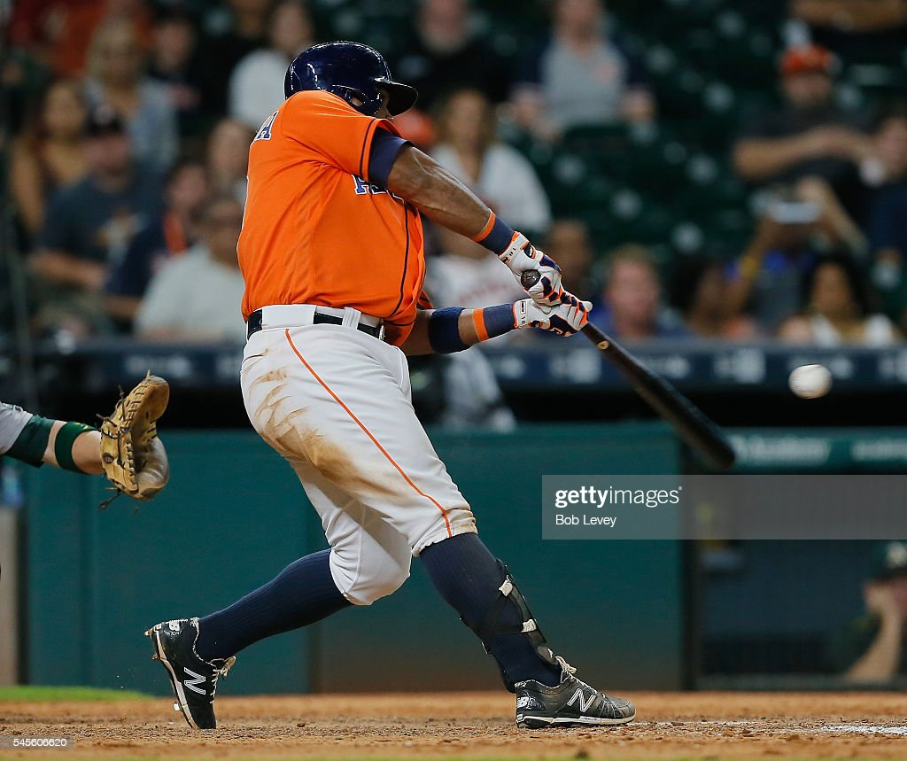 Luis Valbuena #18 of the Houston Astros hits a three run walkoff home run in the ninth inning to defeat the Oakland Athletics at Minute Maid Park on July 8, 2016 in Houston, Texas.