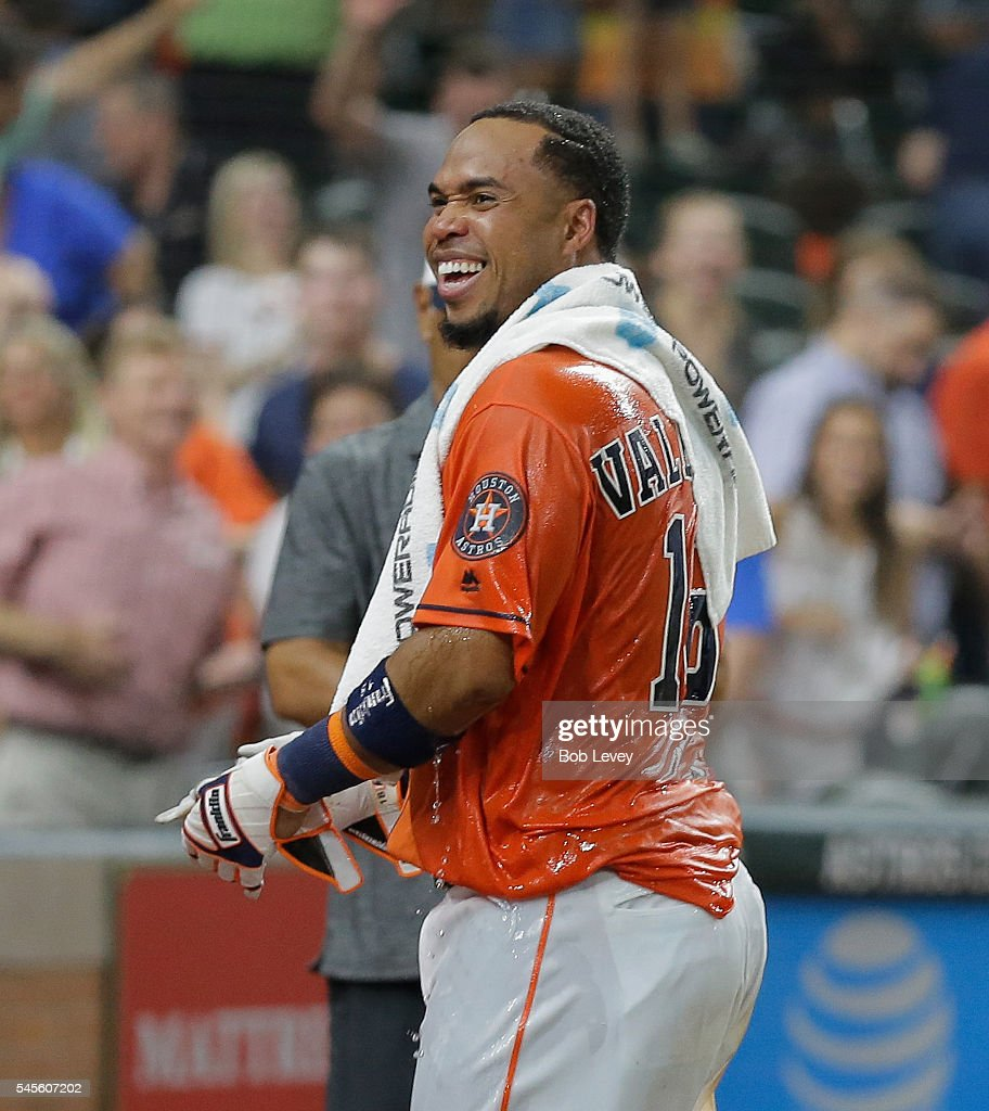 Luis Valbuena #18 of the Houston Astros hits a three run walkoff home run in the ninth inning to defeat the Oakland Athletics 10-9 at Minute Maid Park on July 8, 2016 in Houston, Texas.