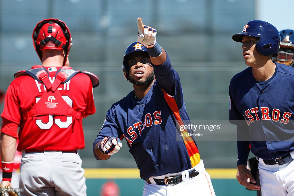 Luis Valbuena #18 of the Houston Astros reacts after hitting a two-run home run against the St. Louis Cardinals in the first inning of a spring training game at Osceola County Stadium on March 4, 2016 in Kissimmee, Florida.
