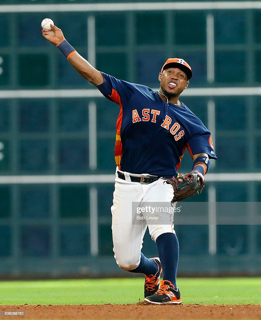 Luis Valbuena #18 of the Houston Astros throws out Stephen Vogt #21 of the Oakland Athletics in the ninth inning to end the game at Minute Maid Park on June 5, 2016 in Houston, Texas.