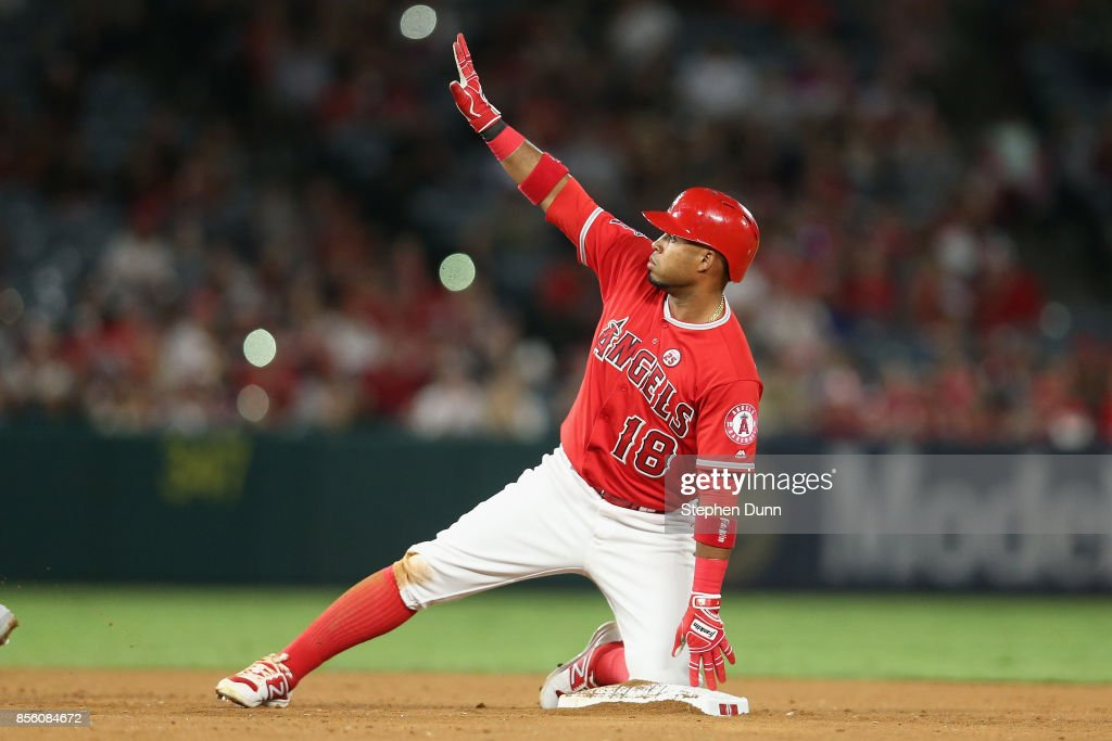 Luis Valbuena #18 of the Los Angeles Angels of Anaheim gestures on second base after hitting an RBI double in the sixth inning against the Seattle Mariners on September 30, 2017 at Angel Stadium of Anaheim in Anaheim, California.