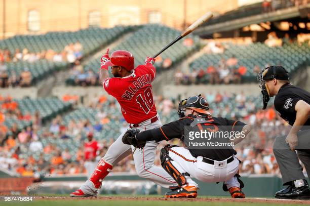 Luis Valbuena of the Los Angeles Angels of Anaheim grounds into a fielder's choice scoring Justin Upton in the third inning against the Baltimore...