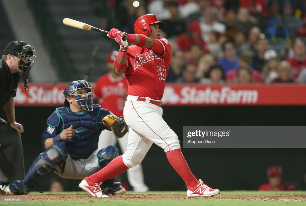 Luis Valbuena #18 of the Los Angeles Angels of Anaheim hits an RBI double in the sixth inning against the Seattle Mariners on September 30, 2017 at Angel Stadium of Anaheim in Anaheim, California.