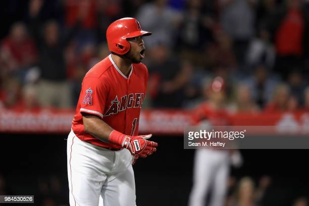 Luis Valbuena of the Los Angeles Angels of Anaheim looks on after hitting a solo homerun during the eighth inning of a game against the Toronto Blue...
