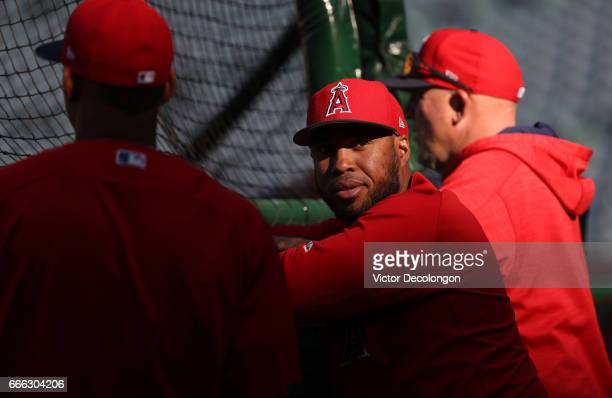 Luis Valbuena of the Los Angeles Angels of Anaheim looks on from behind the batting cage during batting practice prior to the MLB game against the...