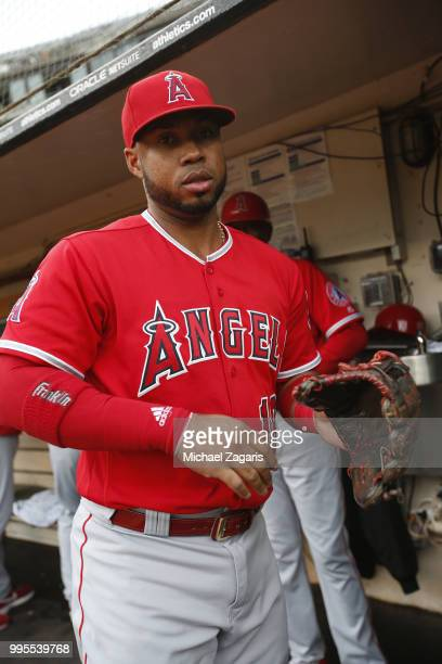 Luis Valbuena of the Los Angeles Angels of Anaheim stands in the dugout prior to the game against the Oakland Athletics at the Oakland Alameda...