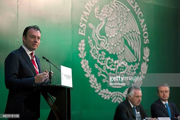 Luis Videgaray Mexico's finance minister left speaks during an event at the Palacio Nacional with Luis Pena Kegel chief executive officer of HSBC...