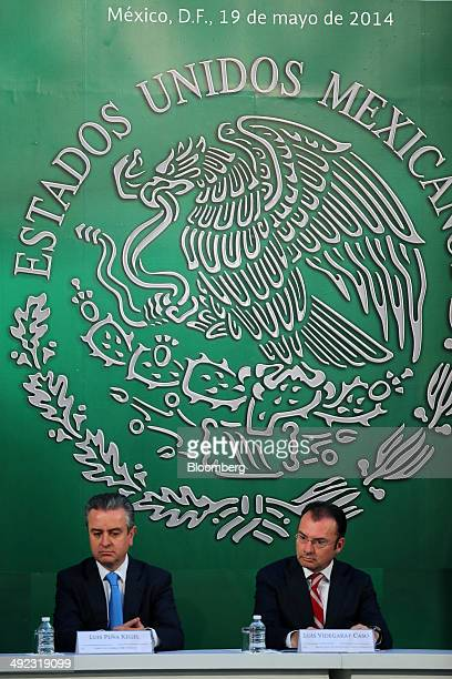 Luis Videgaray Mexico's finance minister right and Luis Pena Kegel chief executive officer of HSBC Mexico listen during an event at the Palacio...