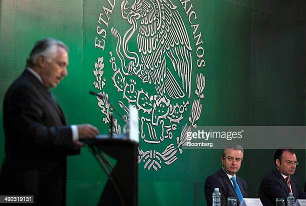 Luis Videgaray Mexico's finance minister right and Luis Pena Kegel chief executive officer of HSBC Mexico second from right listen to Jacques...