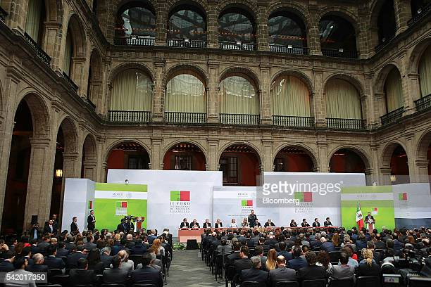 Luis Videgaray Mexico's minister of finance right speaks during a financial inclusion forum at the Palacio Nacional in Mexico City Mexico on Tuesday...