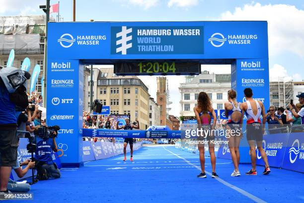 Luis Vincent of France finishes first together with Leonie Periault Cassandre Beaugrand and Dorian Coninx in the ITU World Triathlon Hamburg Mixed...