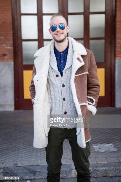 Luis wears Justin boots PullBear trousers Zara coat HM pullover Letfies shirt and RayBan sunglasses on February 11 2018 in Madrid Spain