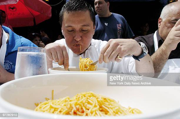 Luis Zambrano representing Lunella restaurant tries to get through his first bowl of spaghetti and marinara sauce during the Third Annual Little...