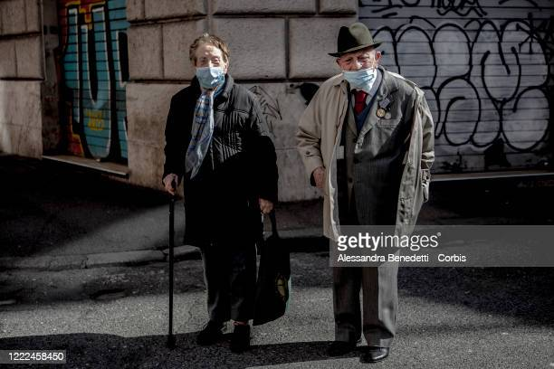 Luisa and Umberto , a former partisan take a stroll in Corso Vittorio on May 2, 2020 in Rome Italy. Italy will remain on lockdown to stem the...