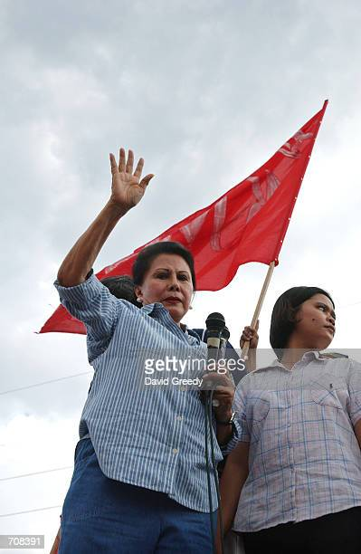 Luisa Ejercita the wife of deposed Philippine President Joseph Estrada delivers a message from her husband nicknamed Erap to supporters outside the...