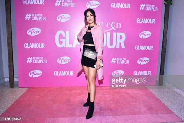 Luisa Fernanda Islas poses for photos during the pink carpet of 'Vive con Glamour' to promote prevention of breast cancer at Terminal 1 Sinaloa on...