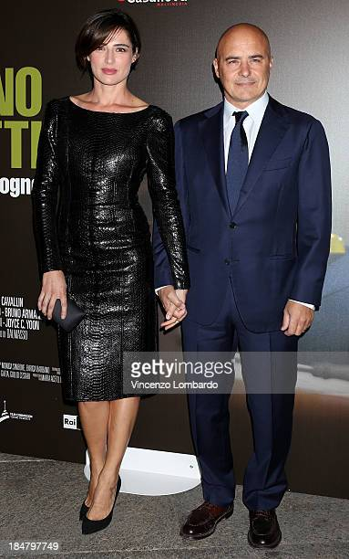 Luisa Ranieri and Luca Zingaretti attend the preview of film Adriano Olivetti La forza di un sogno on October 16 2013 in Milan Italy