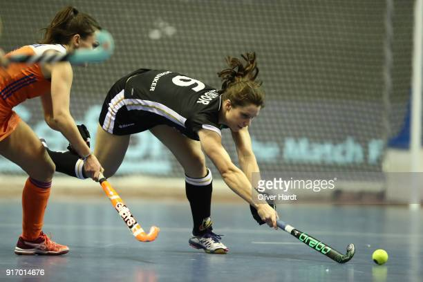 Luisa Steindor of Germany and Kiki van Wijk of Netherlands during the Women Gold Medal Indoor Hockey World Cup Berlin Final Day match between Germany...