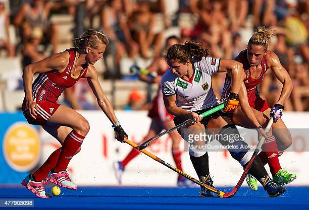 Luisa Steindor of Germany is tackled by Alex Danson and Susannah Townsend of Great Britain during the match between Great Britain and Germany at...