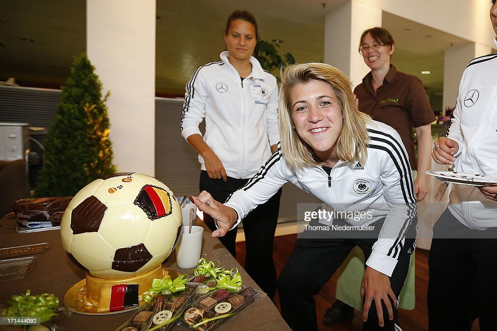Luisa Wensing (C) looks on during the DFB Team & Sponsors Cooking Event on June 24, 2013 in Munich, Germany.