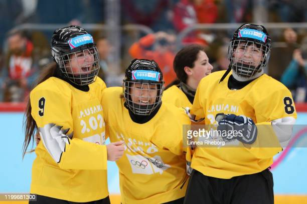 Luisa Wilson of Team Yellow and Mexico, Seyoon Shin of Team Yellow and Korea and Zuzana Trnkova of Team Yellow and Czech Republic celebrate following...