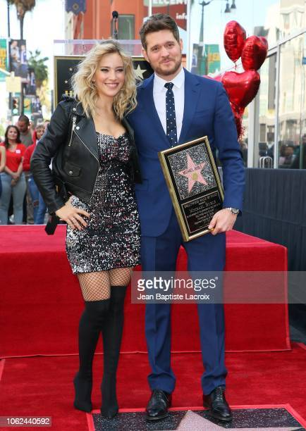 Luisana Lopilato and Michael Buble attend a ceremony honoring him with a star on the Hollywood Walk Of Fame on October 16 2018 in Los Angeles...