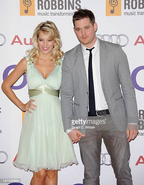 Luisana Lopilato and Singer Michael Buble attend the Nordoff Robbins O2 Silver Clef Awards at the London Hilton Hotel on June 29 2012 in London...