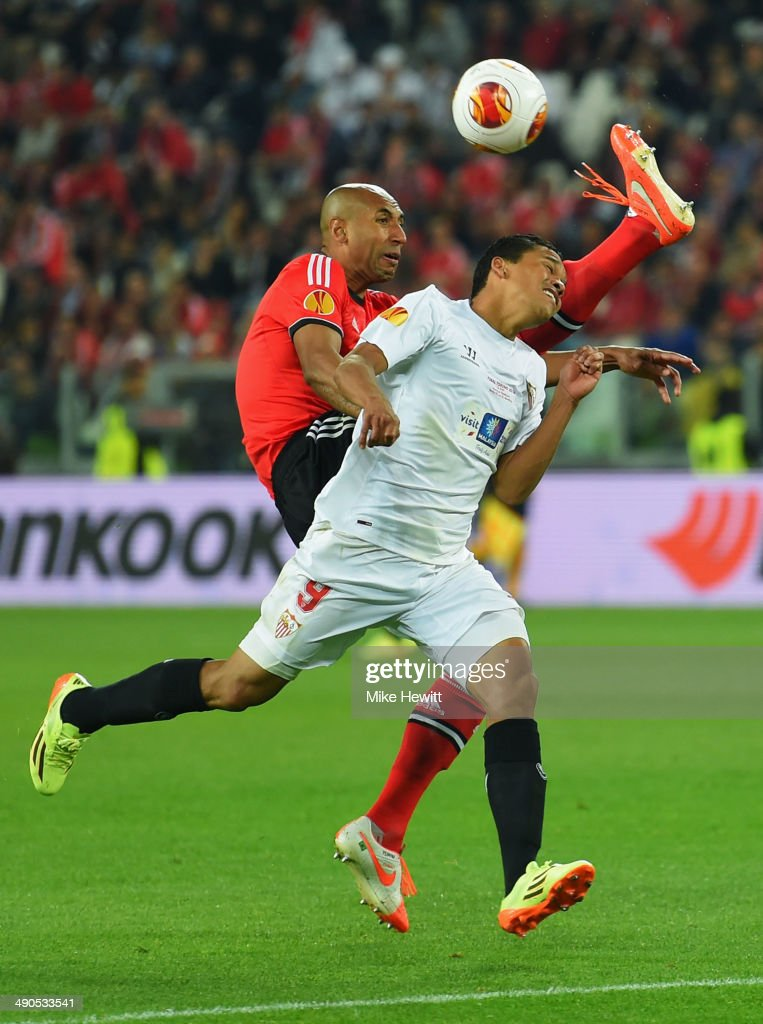 Luisao of Benfica and Carlos Bacca of Sevilla battle for the ball during the UEFA Europa League Final match between Sevilla FC and SL Benfica at Juventus Stadium on May 14, 2014 in Turin, Italy.