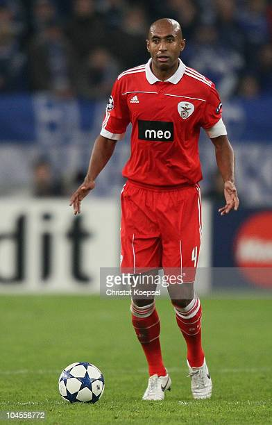 Luisao of Benfica runs with the ball during the UEFA Champions League match between FC Schalke 04 and SL Benfica at Veltins Arena on September 29...