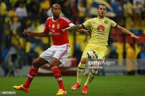 Luisao of Benfica struggles for the ball with Dario Benedetto of America during a match between America and Benfica as part of the International...