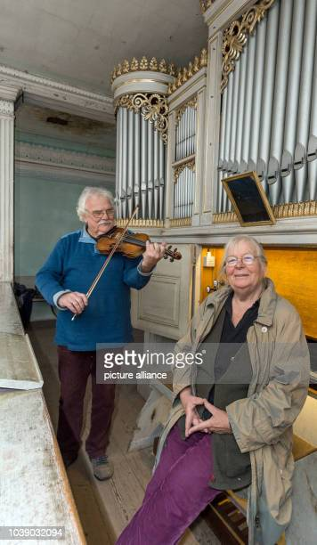 Luise and Goetz Bernau from Neumaedewitz stand in front of the organ in the church in Altmaedewitz Germany 14 December 2015 For years the couple has...