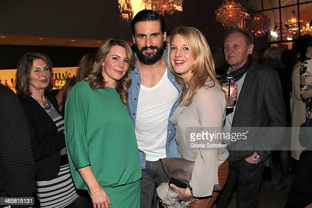 Luise Baehr Tom Beck Eva Maria Greiner attend the premiere of the film 'Vaterfreuden' at Mathaeser Filmpalast on January 29 2014 in Munich Germany