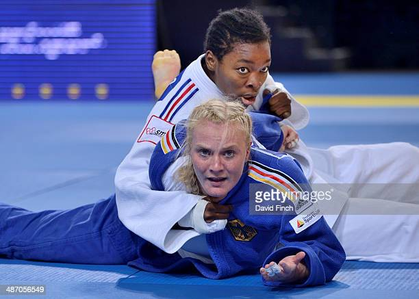 Luise Malzahn of Germany is frustrated after being thrown by Audrey Tcheumeo of France in the closing seconds of their u78kg match and losing during...