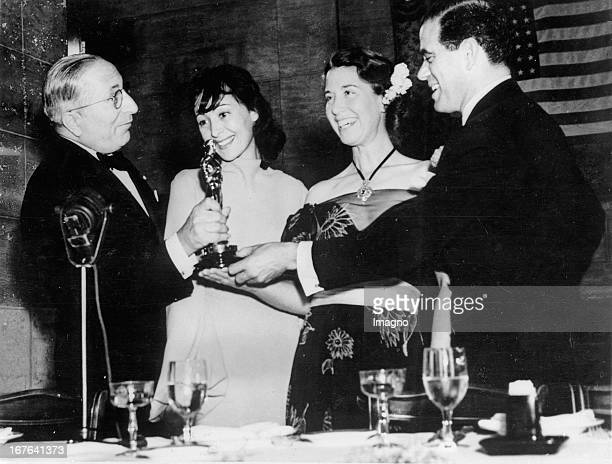 Luise Rainer and Mrs Spencer Tracy getting the Oscar at the Academy Awards To the left film producer Louis B Mayer To the right director Frank Capra...