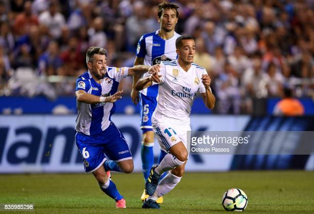 Luisinho of RC Deportivo La Coruna competes for the ball with Lucas Vazquez of Real Madrid during the La Liga match between Deportivo La Coruna and...