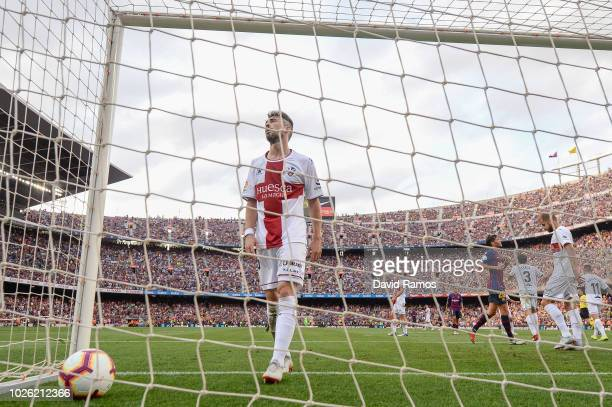 Luisinho of SD Huesca reacts after his team mateJorge Pulido scored an own goal during the La Liga match between FC Barcelona and SD Huesca at Camp...