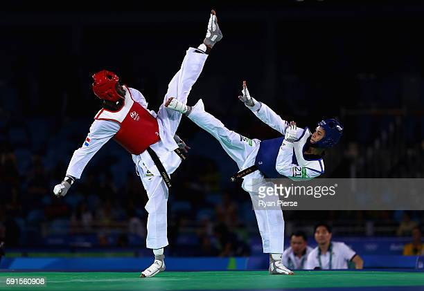 Luisito Pie of the Dominican Republic competes against Tawin Hanprab of Thailand during the Taekwondo Men's 58kg Semi Final contest at Cairoca Arena...