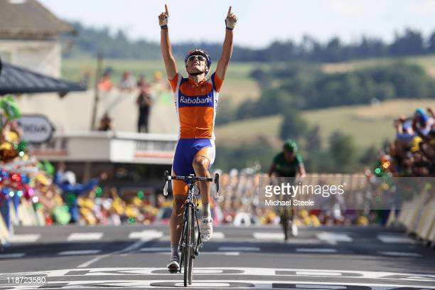 Luis-Leon Sanchez of Spain and Rabobank Cycling Team celebrates victory as he crosses the finish line during Stage 9 of the 2011 Tour de France from...