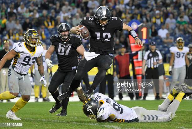 LuisPerez of the Birmingham Iron hurdles DamontreMoore of the San Diego Fleet during the second half in an Alliance of American Football game at...